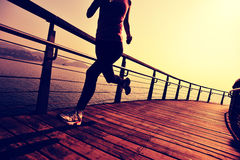 Healthy lifestyle woman running seaside Royalty Free Stock Photos