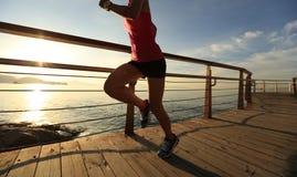 Healthy lifestyle woman running seaside Stock Photo