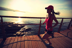 Healthy lifestyle woman running seaside Royalty Free Stock Image
