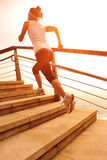 Healthy lifestyle woman running on stone stairs Royalty Free Stock Photo