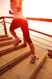 Healthy lifestyle woman running on stone stairs Royalty Free Stock Image