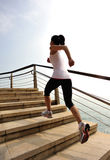 Healthy lifestyle woman running on stone stairs Stock Photo