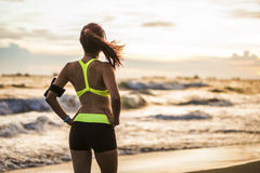 Healthy lifestyle woman running at sunrise beach Stock Images