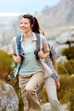 Healthy lifestyle women. Carefree brunette girl walks outdoors hiking and exploring. she is cheerful and happy royalty free stock image