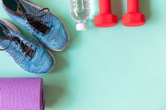 Healthy lifestyle for women diet with sport equipment, sneakers, bottle of water royalty free stock image