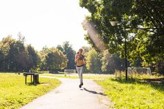 Healthy lifestyle young fitness woman running outdoors.  Stock Images