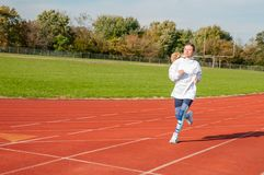 Healthy lifestyle young fitness woman running at outside stock photos