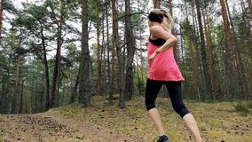 Healthy lifestyle - woman jogging on forest trail stock video footage