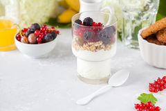 Healthy light breakfast: parfait with berries and yogurt, orange stock images
