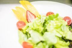 Healthy, light salad with fruits stock photography