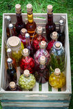 Healthy liqueur with fruits and alcohol in wooden box Stock Photography