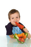 Healthy little boy with vegetables Stock Image