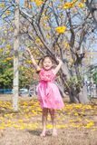 Healthy Little cute girl in pink dress  with yellow flowers. Royalty Free Stock Photo