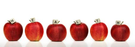 Healthy living. Red apple and cubes with letters in front of a white background - healthcare Stock Photos