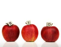 Healthy living. Red apple and cubes with letters in front of a white background - bio Stock Photo