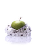 Healthy Living-Apple being measured Stock Photo