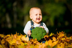 Healthy living - baby with brocoli Stock Photo