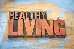 Healthy living banner in wood type stock images