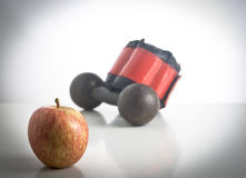 Healthy Living Concept. Apple and work out objects on white background Stock Photo