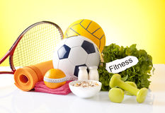 Healthy living concept with g0od food and sport Stock Photography