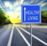 Healthy Living Road Sign on a Speedy Background with Sunset. stock image