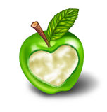 Healthy living with natural food and exercise. Healthy living and good diet with natural food and exercise symbolised by a green apple with a heart shape carved Stock Photography