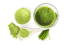 Healthy living. Spirulina, chlorella and wheatgrass. Green food supplement. Spirulina, chlorella and wheatgrass. Green pills, wheatgrass blades and ground Royalty Free Stock Image