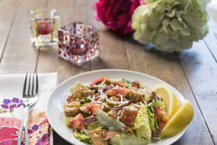 A healthy lobster Caesar salad with peonies Stock Image