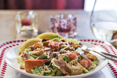 A healthy lobster Caesar salad with white wine Stock Images
