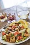 A healthy lobster Caesar salad with white wine Stock Image