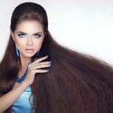 Healthy Long Hair. Beautiful Brunette Girl. Beauty makeup. Fashi. On manicure nails. Jewelry Stock Photos