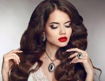 Healthy long hair. Makeup. Jewellery and bijouterie. Beautiful b Stock Image