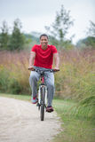 Healthy Looking Young African American Biking Outdoor Royalty Free Stock Images