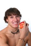 Healthy looking young man holding apple Stock Images
