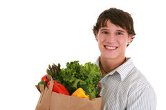 Healthy Looking Young Man Holding Groceries Stock Images
