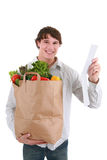 Healthy Looking Young Man Holding Groceries Royalty Free Stock Photography