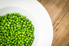 Healthy and lovely green peas in a plate Stock Photography