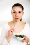 Healthy lovely woman with salad on white background Royalty Free Stock Photography
