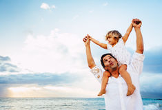 Healthy loving father and daughter playing together at the beach Royalty Free Stock Photography