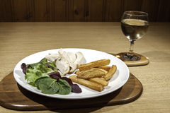 Healthy low calorie chicken meal with salad and wine Royalty Free Stock Images