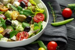 Healthy low calories salad with lettuce, heirloom tomatoes, avocado, feta cheese, red onion, cucumber, sweet peas stock image