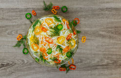 Healthy low calories spring cabbage salad with bell pepper. Corn and dill on a white dish on an old rustic table,view from above Royalty Free Stock Photos