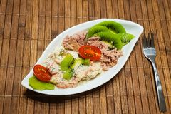 A low carbohydrate diet. Healthy low-carbohydrate food in small bowl, lunch with tomatoes, tuna, kiwi, shrimp homemade sugar-free sauce royalty free stock photos