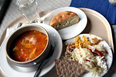 A Healthy Lunch. With Fish Soup, herbal bread and salad. Taken in a restuarant in Sweden stock image