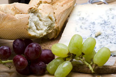 Healthy lunch. A healthy platter of bread, cheese, and fresh grapes Royalty Free Stock Photography