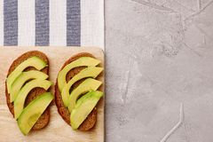 Healthy lunch avocado sandwiches top view breakfast concept stock photo