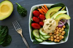 Healthy lunch bowl with super-foods and fresh vegetables royalty free stock images