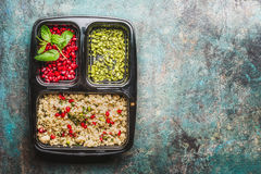 Healthy lunch box with salad, pomegranate and pistachios nuts on rustic background, top view stock photos