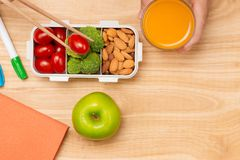 Healthy lunch box with sandwich and fresh vegetables, bottle of. Water. Healthy eating concept. Top view Royalty Free Stock Image