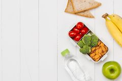 Healthy lunch box with sandwich and fresh vegetables, bottle of. Water. Healthy eating concept. Top view Stock Images